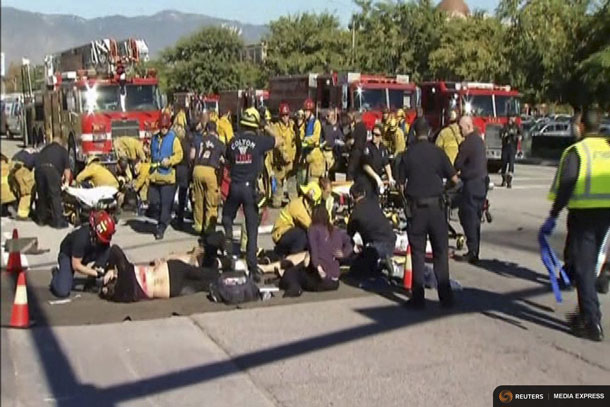 Rescue crews tend to the injured in the intersection outside the Inland Regional Center in San Bernardino, California in this still image taken from video December 2, 2015. REUTERS/NBCLA.com/Handout via Reuters