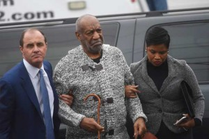 Actor and comedian Bill Cosby (C) arrives with attorney Monique Pressley (R) for his arraignment on sexual assault charges at the Montgomery County Courthouse in Elkins Park, Pennsylvania December 30, 2015. REUTERS/Mark Makela