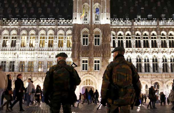 "Belgian soldiers patrol along ""Winter Wonders"", a Christmas market on Brussels' Grand Place, Belgium, December 24, 2015, following tight security measures linked to the fatal attacks in Paris. REUTERS/Francois Lenoir"