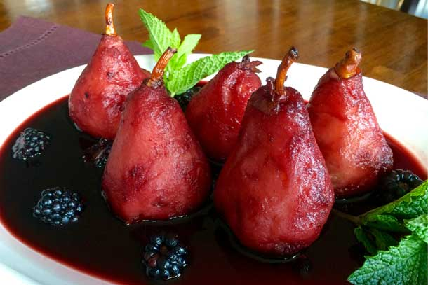 Prepare festive fruits for your holiday table, such as wine poached pears with blackberries. Credit: Copyright 2015 P.K. Newby