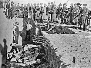 Victims of Wounded Knee Massacre buried in a mass grave
