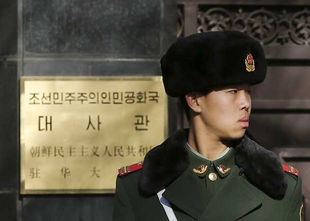 A paramilitary solider stands guard at the main gate of North Korea's embassy in Beijing January 6, 2016. North Korea said it had successfully conducted a test of a miniaturised hydrogen nuclear device on Wednesday morning. REUTERS/Kim Kyung-Hoon