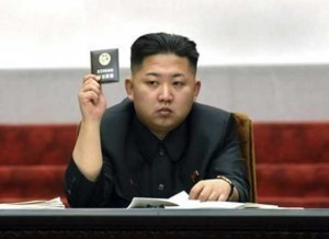 North Korean leader Kim Jong-Un holds up his ballot during the fifth session of the 12th Supreme People's Assembly of North Korea at the Mansudae Assembly Hall in Pyongyang April 13, 2012, in this file picture released by the North's KCNA on April 14, 2012. REUTERS/KCNA/Files
