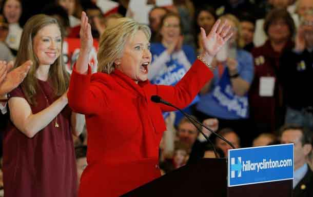 Hillary Clinton at her caucus night rally in Des Moines. REUTERS/Brian Snyder