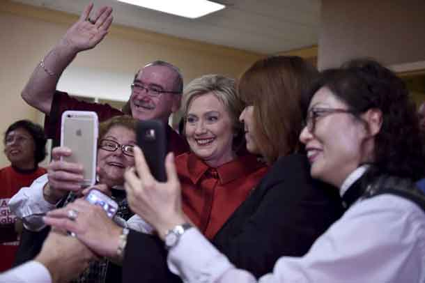 Hillary Clinton meets employees during a campaign stop on caucus day at Harrah's Las Vegas in Las Vegas, Nevada February 20, 2016. REUTERS/David Becker