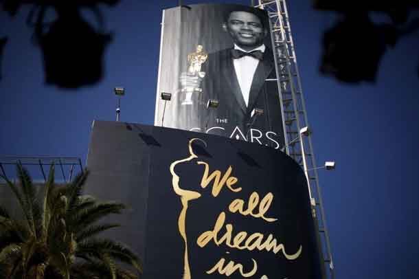 Oscars host Chris Rock is seen on a poster at the entrance to the Dolby Theatre red carpet on Hollywood Boulevard as preparations continue for the 88th Academy Awards in Hollywood, Los Angeles, California February 27, 2016. REUTERS/Lucy Nicholson