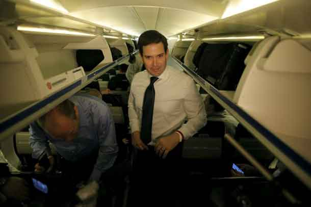 U.S. Republican presidential candidate Marco Rubio pauses before speaking with the media on his campaign plane before departing from West Columbia, South Carolina February 20, 2016. REUTERS/Chris Keane