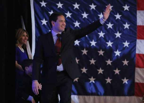 Republican U.S. presidential candidate Senator Marco Rubio waves to supporters as he takes the stage before speaking at the Rubio caucus watch party at the Downtown Marriott Hotel in Des Moines, Iowa February 1, 2016. REUTERS/Aaron P. Bernstein