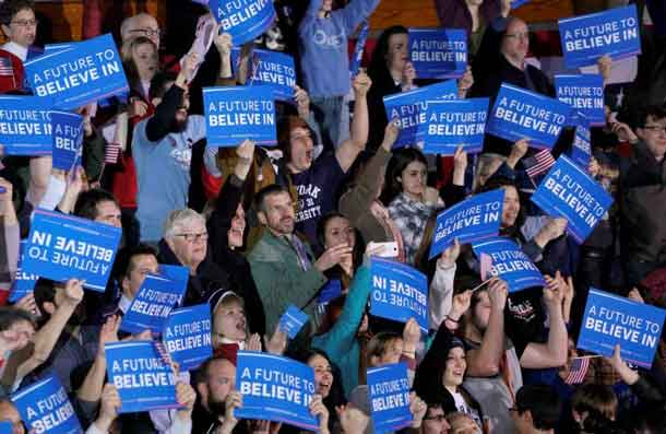 Supporters of Democratic U.S. presidential candidate Bernie Sanders, react as CNN projects a win for Sanders at his 2016 New Hampshire presidential primary night rally in Concord, New Hampshire February 9, 2016. REUTERS/Rick Wilking