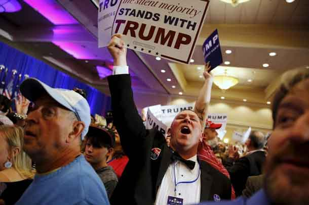 Supporters of U.S. Republican presidential candidate Donald Trump celebrate the close of the polls as they watch election results at a rally in Spartanburg, South Carolina February 20, 2016. REUTERS/Jonathan Ernst
