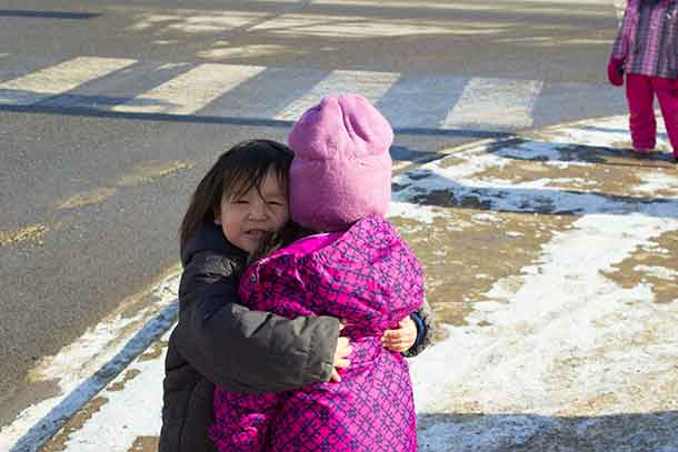 The Valentine's Day Memorial Walk brought out a small but determined crowd. These two shared time making snow angels and a hug.