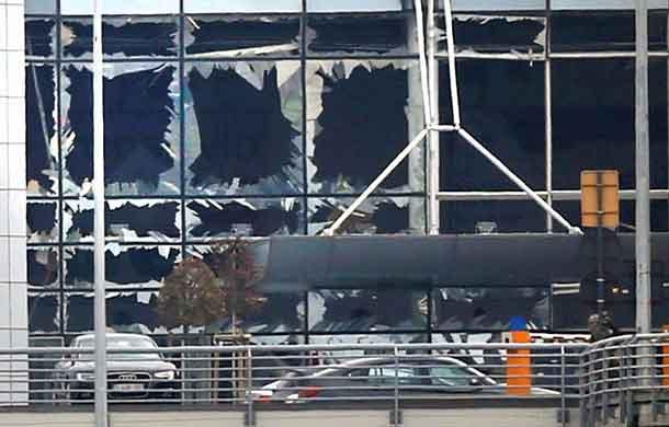 Broken windows seen at the scene of explosions at Zaventem airport near Brussels, Belgium, March 22, 2016. REUTERS/Francois Lenoir