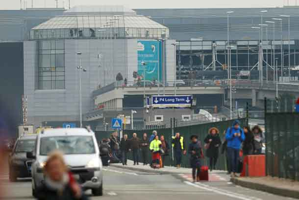 People leave the scene of explosions at Zaventem airport near Brussels, Belgium, March 22, 2016. REUTERS/Francois Lenoir