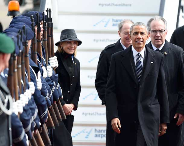 U.S. President Barack Obama is welcomed after his arrival at Hanover airport, Germany April 24, 2016. REUTERS/Nigel Treblin