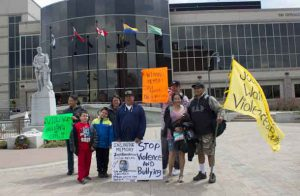 Walkers honouring Josh Nanokeesic from Big Trout Lake . KI First Nation Completed their annual walk to raise awareness on bullying and violence today at City Hall in Thunder Bay