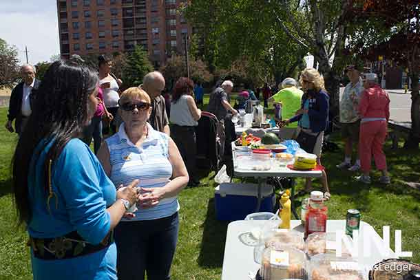 Food, folks, and new friends gathered at Paterson Park to enjoy fellowship.