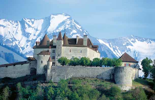 Switzerland. get natural. Gruyeres castle, built in the 11th century, with mount Vanil Noir (2398 m) in the background. Schweiz. ganz natuerlich. Das im 11. Jahrhunder erbaute Schloss Gruyeres mit dem Vanil Noir (2398 m) im Hintergrund. Suisse. tout naturellement. Chateau de Gruyeres, edifie au 11e siecle, avec au fond le Vanil Noir (2398 m). Copyright by: Switzerland Tourism By-Line: swiss-image.ch/Christof Sonderegger