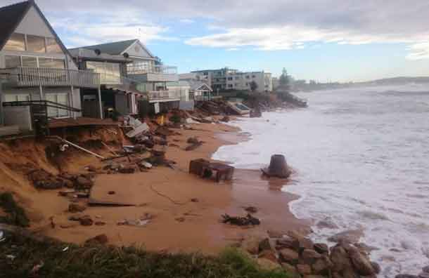 Damaged homes along the foreshore of Sydney's Collaroy Beach, hit by powerful storms in early June. CREDIT Mitchell Harley/UNSW