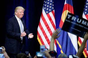 Republican presidential nominee Donald Trump walks on stage at a campaign rally in Colorado Springs, Colorado, U.S., July 29, 2016. REUTERS/Carlo Allegri