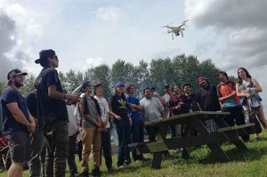 Participant Antoine Boyce (second from left) of Fort Hope First Nation flies a drone during Science Week, part of the First Nations Youth Employment Programs offered in partnership with Outland, Confederation College and Lakehead University