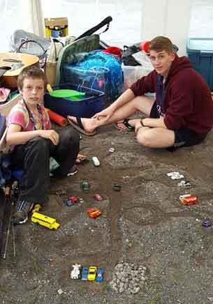Owen and his companion Scott building a toy car city