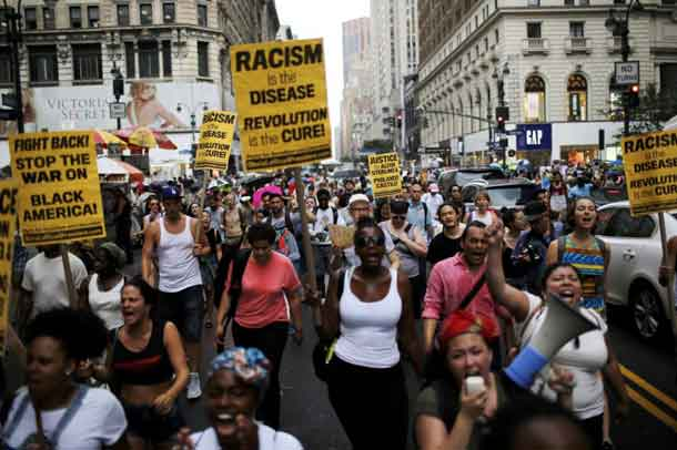 People take part in a protest for the killing of Alton Sterling and Philando Castile during a march along Manhattan's streets in New York July 7, 2016. REUTERS/Eduardo Munoz