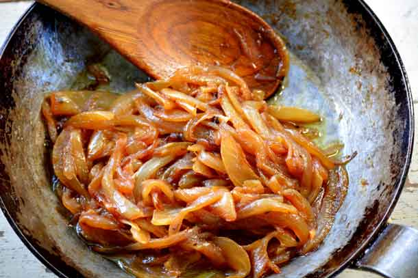 Onions caramelizing in the pan. Credit: Copyright 2016 Lynne Curry