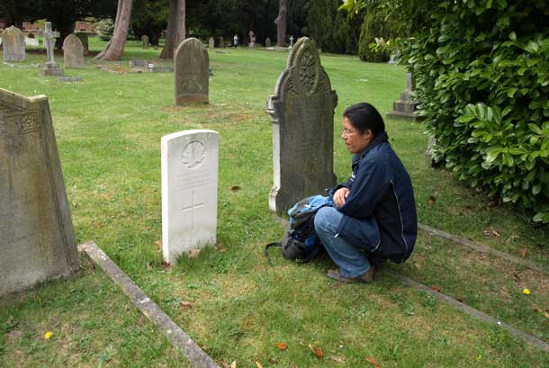 John Chookomolin's final resting place is in St Jude's Cemetery in Englefield Green, UK. Here we see Xavier Kataquapit at the grave of his great grandfather during his visit to England in 2011.