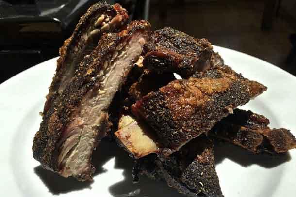 Dry rub pork ribs cut apart after slow roasting and ready for serving. Credit: Copyright 2016 David Latt
