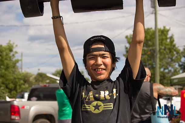 Testing your own strength in the Youth Zone at Thunder Bay's Strongest Man competition. Skylar shows his potential. Photo by Kateri Perreault