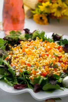 Colorful Corn Salad. This quick stir-fry using fruity extra virgin olive oil, fresh corn kernels, a colorful mix of chopped bell peppers and red onion needs only salt, pepper, cilantro and lemon juice to finish. Serve on a bed of fresh greens. Credit: Copyright 2016 Caroline J. Beck