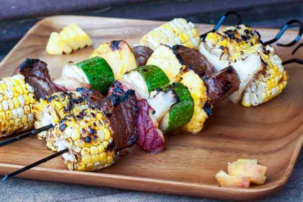 Jerk Lamb Corn and Fruit Kebabs. Jamaican jerk spices rubbed into the lamb add a Caribbean punch to any grilling. The allspice -- key to Jamaican food -- unexpectedly highlights the juicy fruit and sweet corn. Serve with a rum punch. Credit: Copyright 2016 Tami Weiser