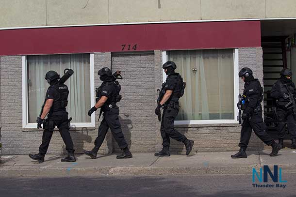 Members of the Thunder Bay Police Service Tactical Unit leaving the incident scene at 17:04EDT