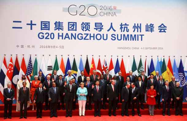 Leaders, including Britain's Prime Minister Theresa May (2nd row, 2nd L), pose for pictures during the G20 Summit in Hangzhou, Zhejiang province, China September 4, 2016. REUTERS/Damir Sagolj/File Photo