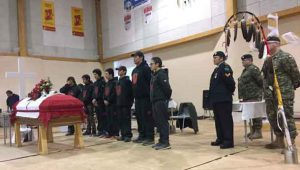 Junior Canadian Rangers stand behind Junior Ranger Garrett Tomagatick's coffin. credit: Master Corporal Vicky Edwards, Canadian Rangers