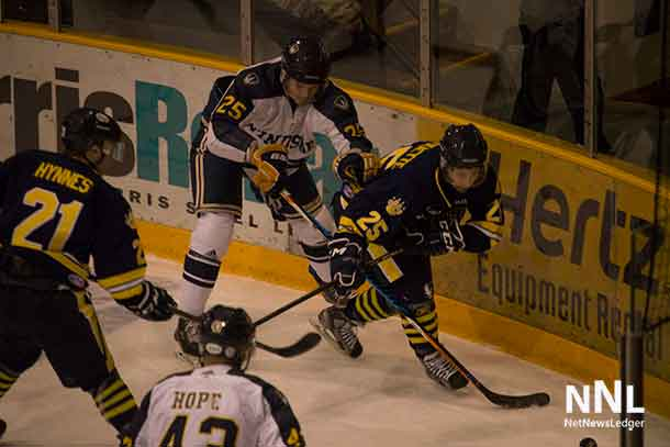 Thunderwolves Battle for the puck against the Windsor Lancers.