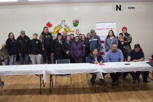 Community members in Fort Severn share smiles after signing of agreement