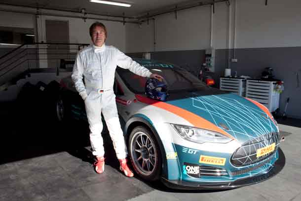 Heinz Harald Frentzen of Germany standing in front of a race version of a Tesla Model S P85+ after Frentzens race tests in Le Castellet, France, on 19-10-2016.