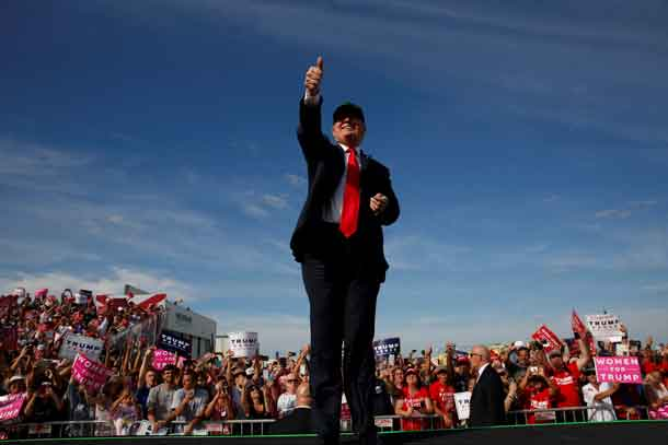 Donald Trump rallies with supporters at the Million Air Orlando airplane hangar in Sanford, Florida. REUTERS/Jonathan Ernst