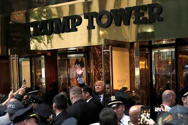 Republican presidential nominee Donald Trump waves to supporters outside the front door of Trump Tower where he lives in the Manhattan borough of New York, U.S., October 8, 2016. REUTERS/Mike Segar