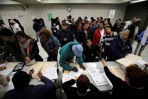 Voters register to vote during the U.S. presidential election at a polling station in the Bronx Borough of New York, U.S., November 8, 2016. REUTERS/Saul Martinez
