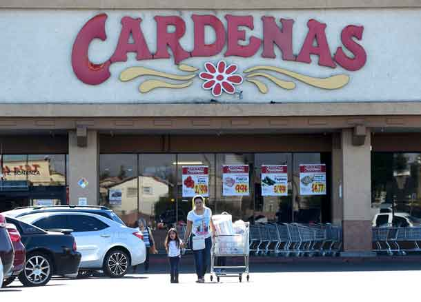 Customers exit Cardenas supermarket, where an advance polling station for the U.S. presidential election was allowed to remain open late on November 4, in a east side neighborhood of Las Vegas, Nevada, U.S. November 8, 2016. REUTERS/David Becker