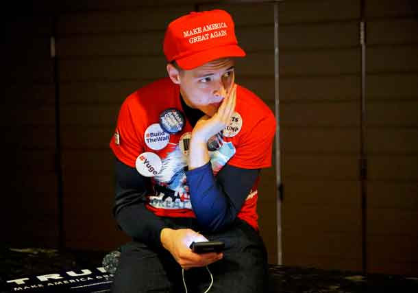 A Trump supporter waits for the Trump rally to begin at the Hilton Hotel during the U.S. presidential election in New York City, New York, U.S. November 8, 2016. REUTERS/Andrew Kelly