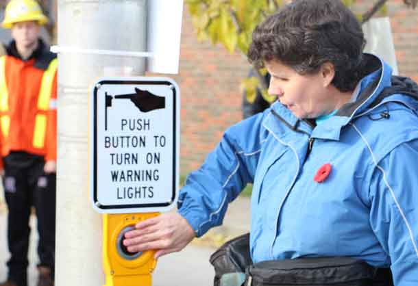 Push the button and cross the street - New crosswalk opened on Algoma Street