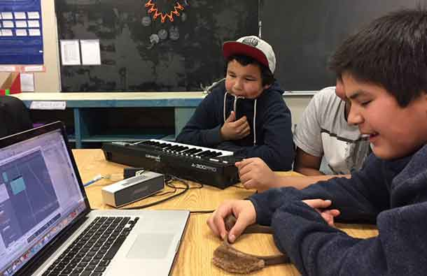 Marten Falls (Ogoki Post) youths engineer the song that youths created.