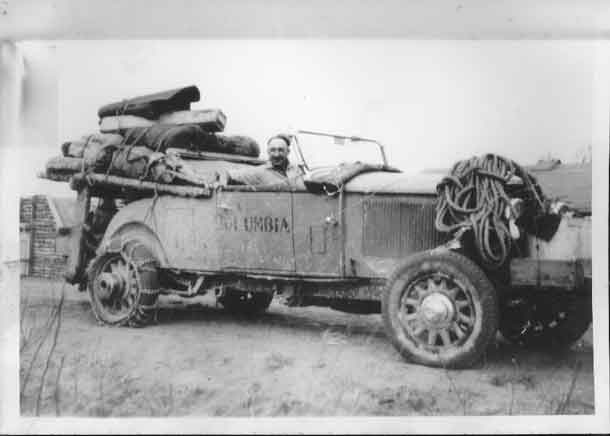 The McLaughlin-Buick arrives in Cameron Falls. Note the missing fenders and running boards, the ragtop, the heavy rope for winching, and the special rear-wheel hubs. Photo courtesy Nipigon Museum