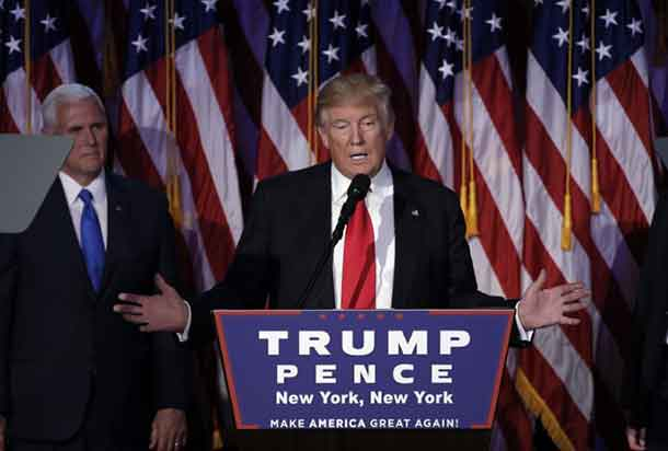 U.S. President-elect Donald Trump addresses supporters during his election night rally in Manhattan, New York, U.S., November 9, 2016. REUTERS/Mike Segar