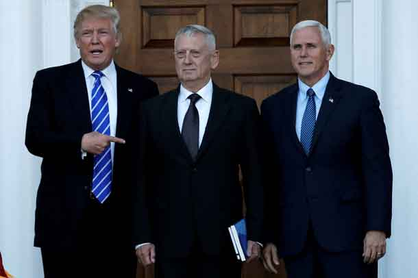 U.S. President-elect Donald Trump (L) and Vice President-elect Mike Pence (R) greet retired Marine General James Mattis in Bedminster, New Jersey, U.S., November 19, 2016. REUTERS/Mike Segar/File Photo