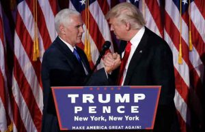 Donald Trump greets his running mate Mike Pence during his election night rally in Manhattan. REUTERS/Mike Segar