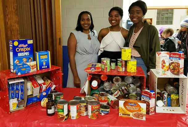 Dianna Atkinson, President of CAMAT; Takwana Nhau, Shelter House; Matilda Ankrah, President of the African Caribbean Student Association at LU. Food donations collected by CAMAT for the Shelter House Thunder Bay.